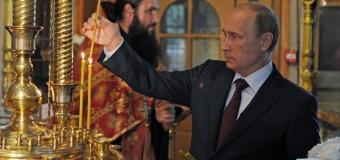 Путин поставил свечи за тех, кто пострадал и погиб в Новороссии. Видео