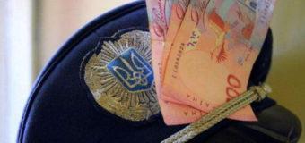 Киевские полицейские-взяточники присвоили более 10 млн грн