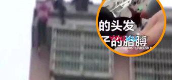 Китаец спас свою жену-самоубийцу от падения с крыши, поймав ее за волосы. Видео